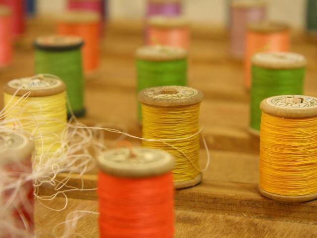 Bobines de fil au Musée de la Broderie