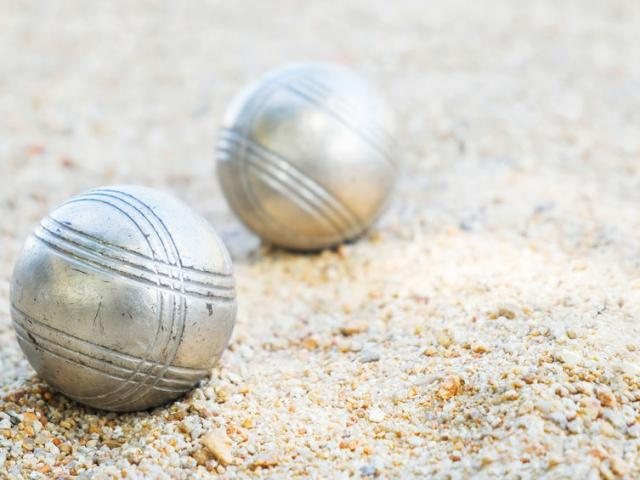 88849118 - petanque  balls on the field with nobody.