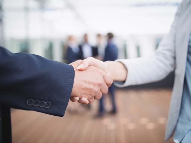 Close-up of businesspeople shaking hands