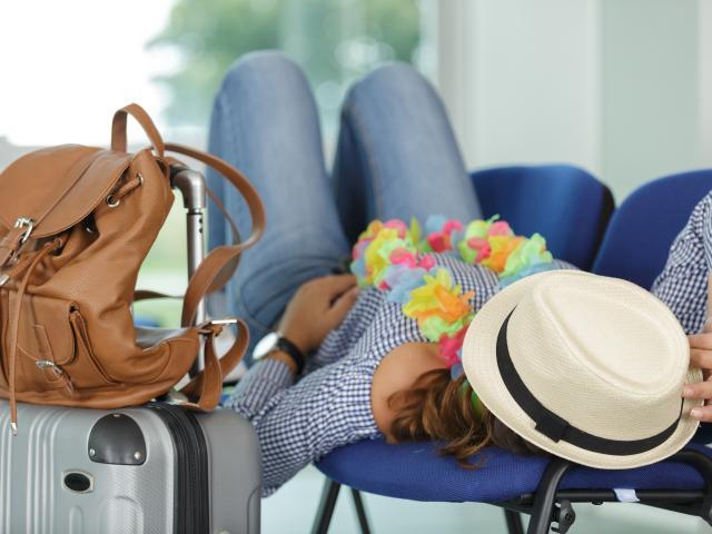 woman sleeping at airport
