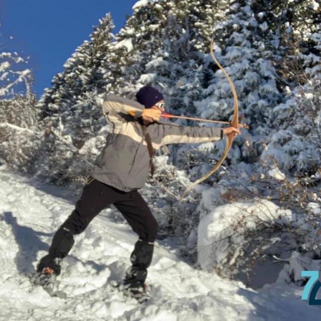 Tir à L'arc Dans La Neige