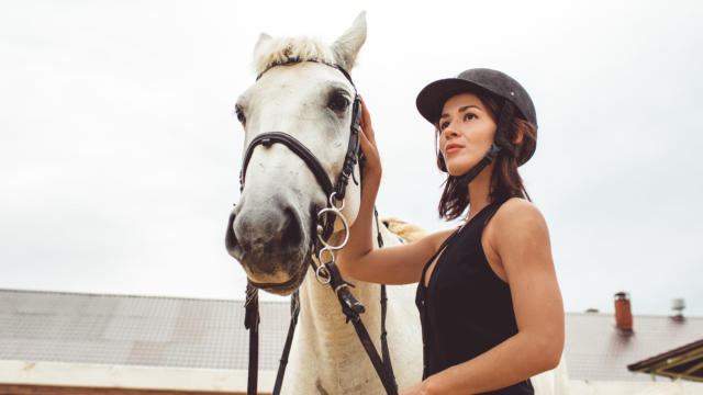 girls learn how to ride horses