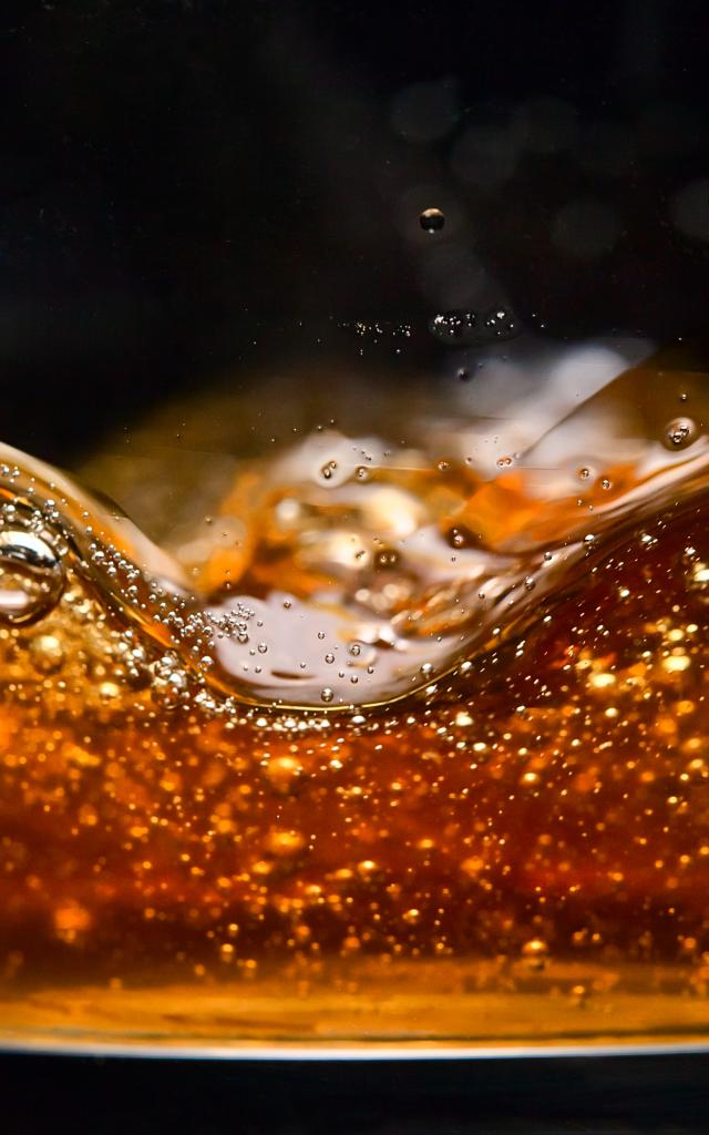 detail of an alcoholic beverage on black background