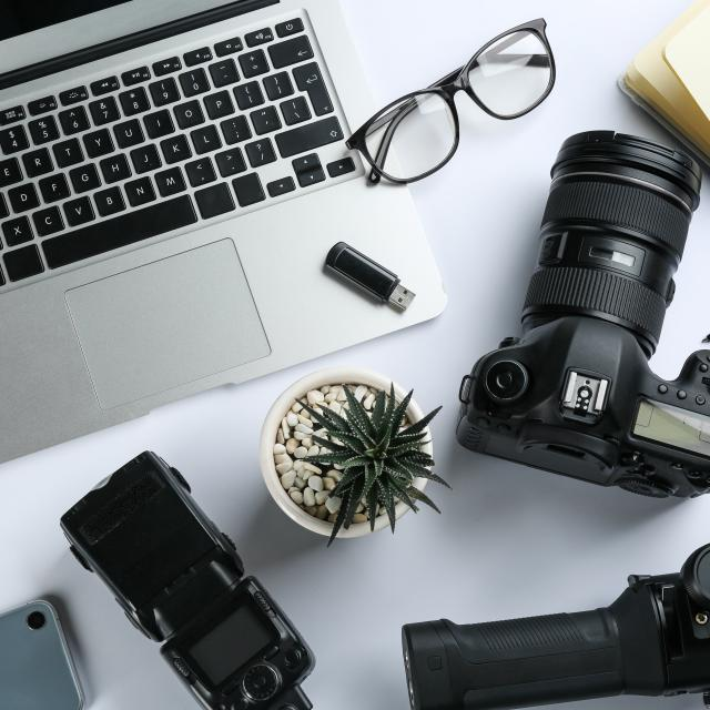 Composition with camera and video production equipment on white background, top view