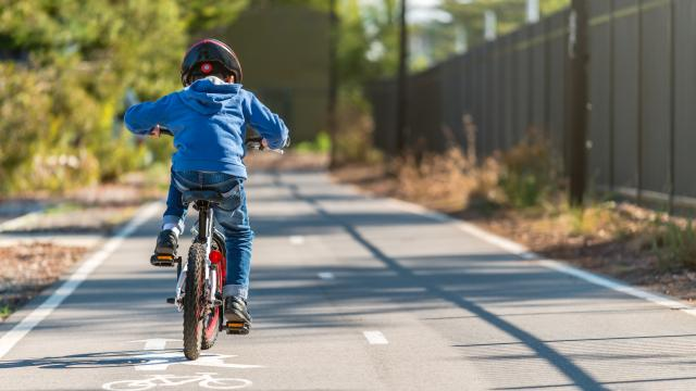 Australian boy riding his bicycle on bike lane on a day, South Australia